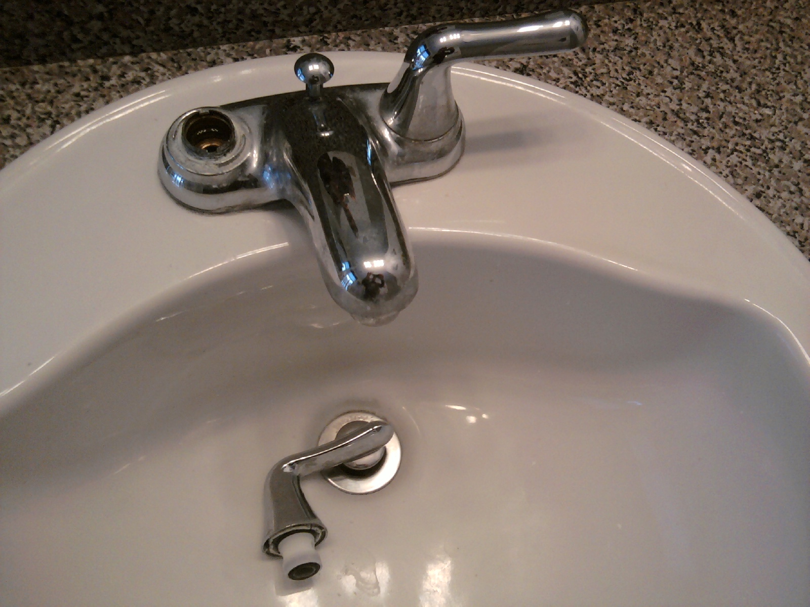 replacing a bathroom faucet and drain all about the house