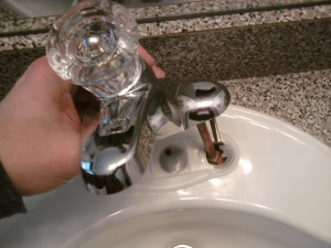 Positioning the New Bathroom Faucet for Installation