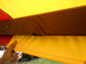 Damaged Redwood Swing Set Tarp Board