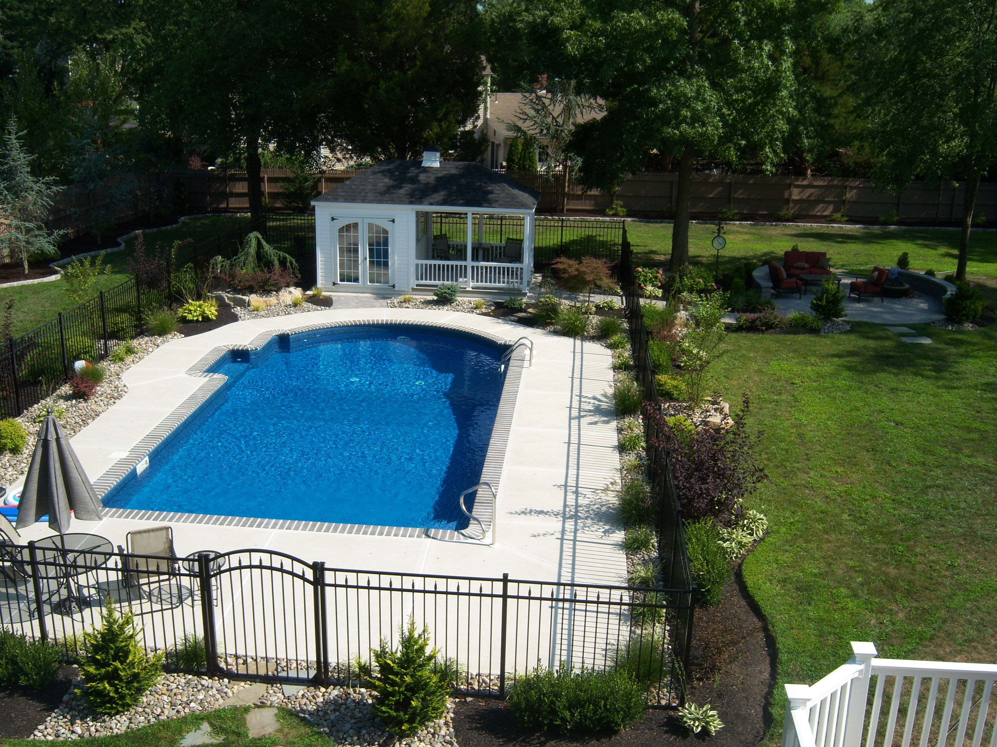 Refreshing a swimming pool landscape all about the house for Backyard inground pool ideas