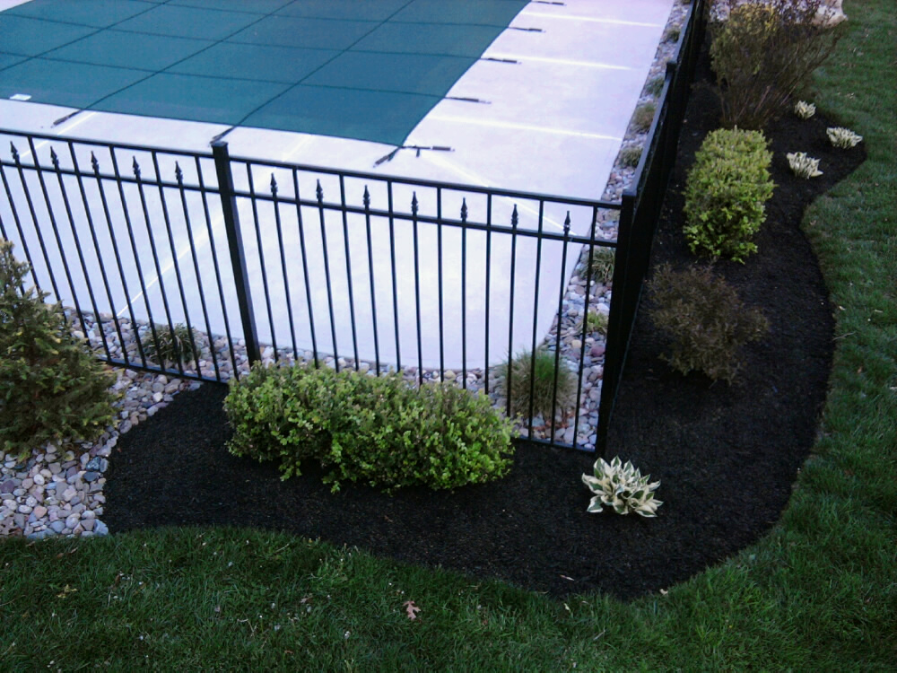 Refreshing a swimming pool landscape all about the house for Pool garden edging