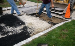 Removing Asphalt by Paver Apron