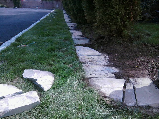 Creating a natural stone landscape border all about the - Natural stone garden edging ...