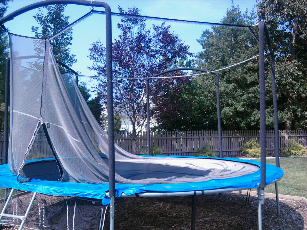 repairing a backyard trampoline all about the house