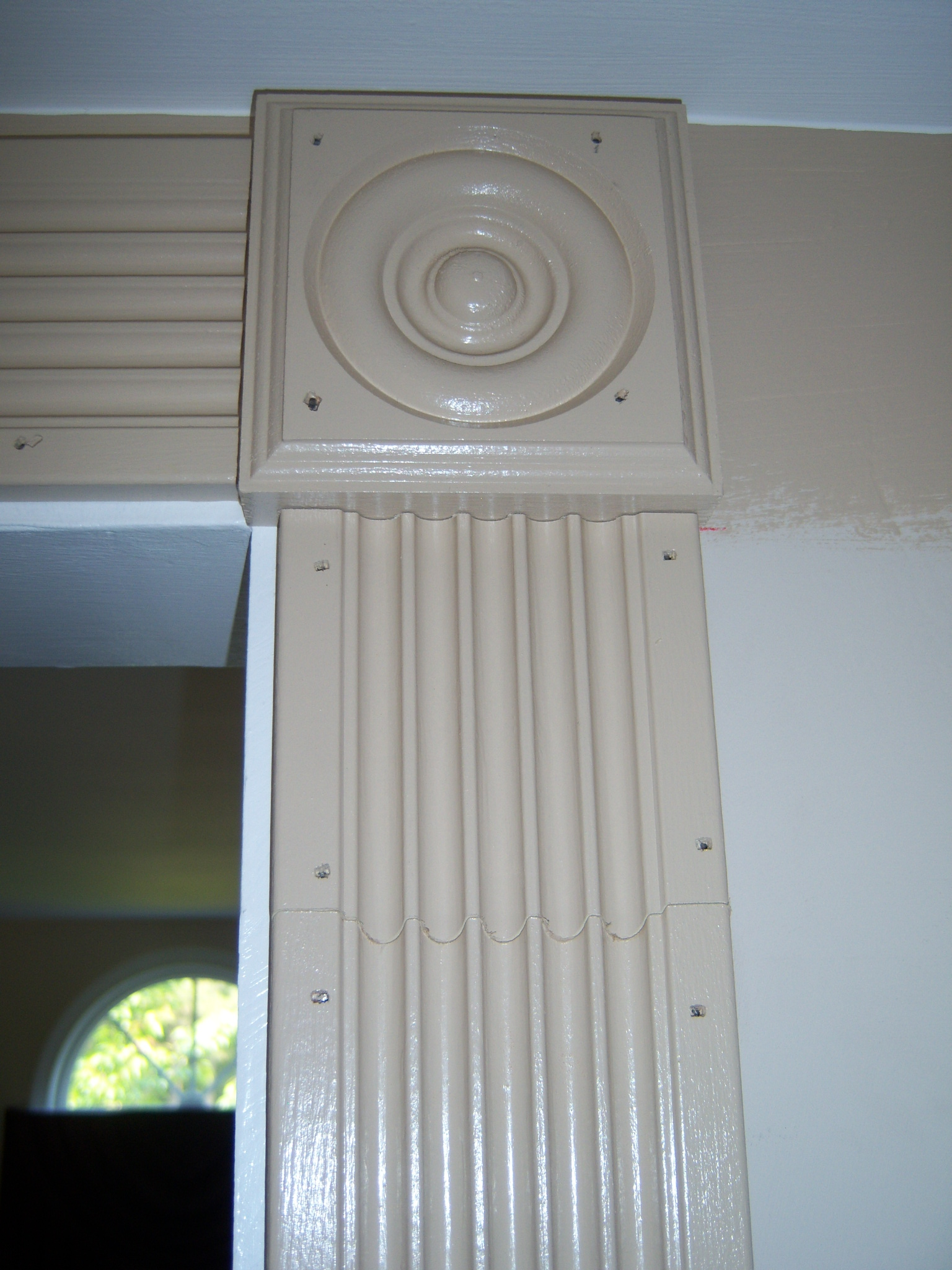 Dressing Up An Archway With Fluted Casing And Rosettes