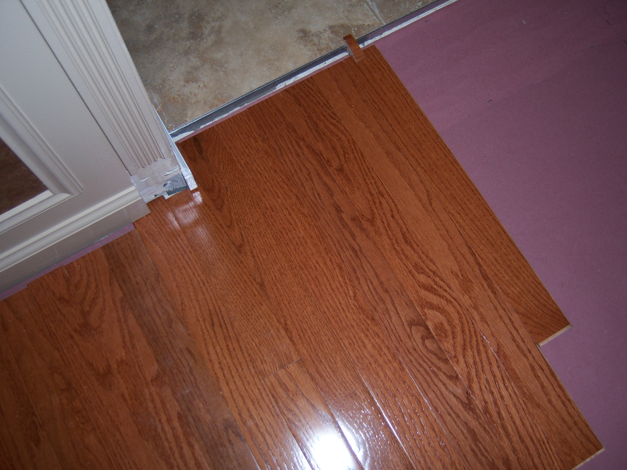 Hardwood floor installation and trim work all about the house