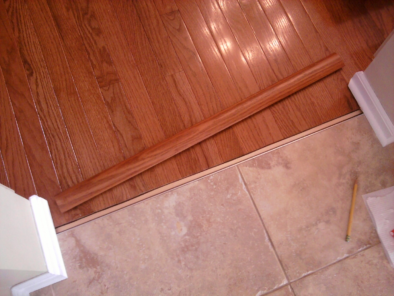 Hardwood floor installation and trim work all about the for Tile and hardwood floor