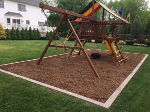 Redwood Play Set Fiber Mulch Installation