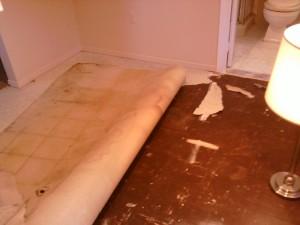 Decrepit Vinyl Flooring Over Old Tile