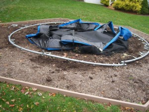 Hurricane Damaged Trampoline Hexagon Mulch Area