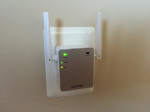 WiFi Extender Plugged Into Home Electrical Outlet