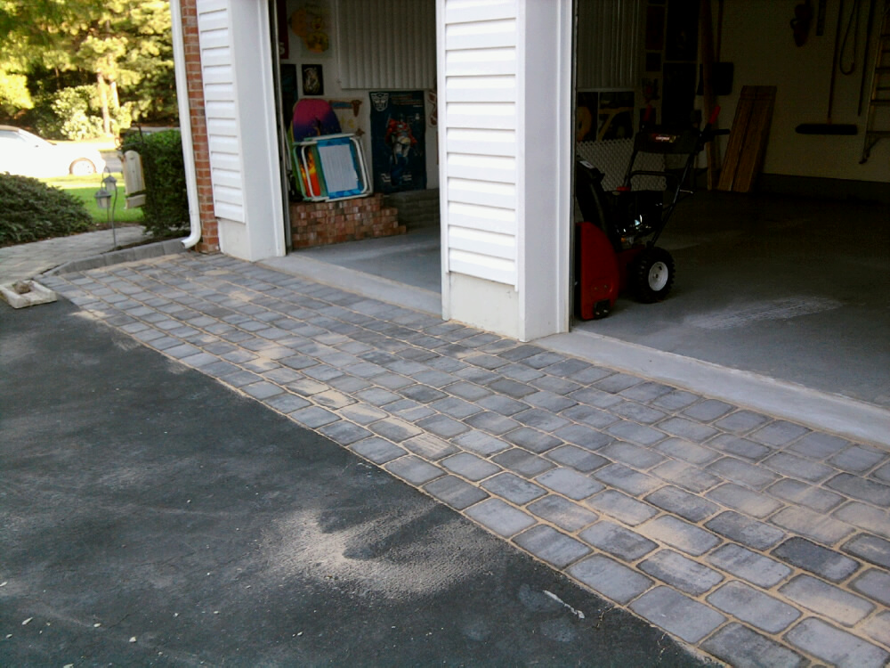 Belgian block and pavers dressing up an asphalt driveway for Driveway apron ideas